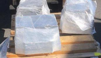 The shipment contained three aluminum blocks, shrink-wrapped and palletized, each weighing approximately 165 pounds.